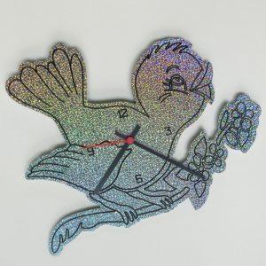 Orologio con uccellino sul ramo
