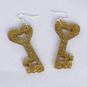 Orecchini plexiglass oro glitter a forma di chiave